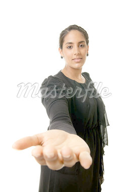 a young indian woman offering her hand for help Stock Photo - Royalty-Free, Artist: Jerax                         , Code: 400-04397268