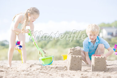 Brother and sister at beach making sand castles Stock Photo - Royalty-Free, Artist: MonkeyBusinessImages          , Code: 400-04402128