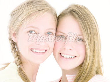 Two girl friends together smiling Stock Photo - Royalty-Free, Artist: MonkeyBusinessImages          , Code: 400-04402287