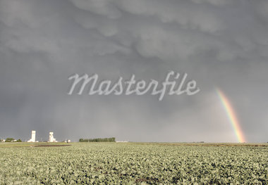 Prairie Grain Elevator in Saskatchewan Canada with storm clouds and rainbow Stock Photo - Royalty-Free, Artist: pictureguy                    , Code: 400-04402406