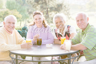 Friends Enjoying A Beverage By A Golf Course Stock Photo - Royalty-Free, Artist: MonkeyBusinessImages          , Code: 400-04404247