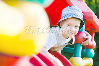 Little boy on playground Stock Photo - Royalty-Free, Artist: kaznadey                      , Code: 400-04407549