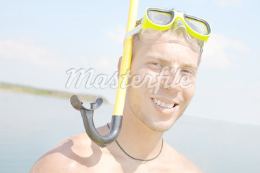 Portrait of a man in scuba looking at camera and smiling Stock Photo - Royalty-Free, Artist: pressmaster                   , Code: 400-04407625