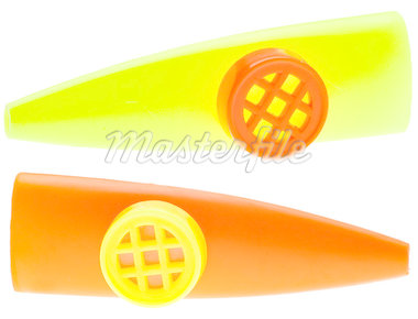 Pair of Kazoo Noise Makers Isolated on White with a Clipping Path. Stock Photo - Royalty-Free, Artist: brookebecker                  , Code: 400-04408377