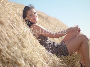 young woman in a dress on a haystack Stock Photo - Royalty-Free, Artist: fotoluxstudio                 , Code: 400-04409063