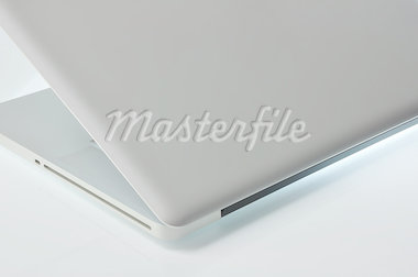 Laptop on a glossy surface illumination. Side View. Stock Photo - Royalty-Free, Artist: Gordya                        , Code: 400-04410531