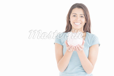 Beautiful woman posing with a piggy bank while standing against a white background Stock Photo - Royalty-Free, Artist: 4774344sean                   , Code: 400-04416056