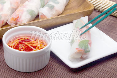 Asian spring roll in rice paper on a white plate and red sauce. Stock Photo - Royalty-Free, Artist: VIPDesignUSA                  , Code: 400-04420421