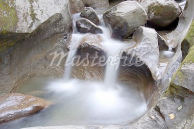 Picture of a small stream with some water falls Stock Photo - Royalty-Free, Artist: nialat                        , Code: 400-04461535