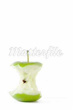 Isolated fresh green apple eaten to the core located in the bottom left with room for text to be added. Stock Photo - Royalty-Free, Artist: Mariec                        , Code: 400-04474787