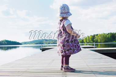 Girl Standing on Dock Stock Photo - Premium Royalty-Free, Artist: I. Jonsson, Code: 600-04525175