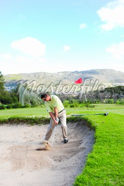 A professional golfer playing a shot out of a sand-trap with excellent control. Stock Photo - Royalty-Free, Artist: Vatikaki                      , Code: 400-04547836