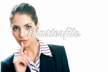 Image of business lady in suit holding her finger near the mouth Stock Photo - Royalty-Free, Artist: pressmaster                   , Code: 400-04560396