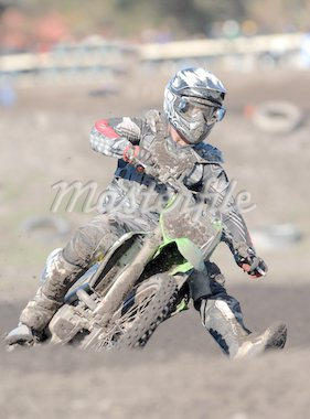 A muddy motocross rider in action during a race Stock Photo - Royalty-Free, Artist: sportlibrary                  , Code: 400-04562629