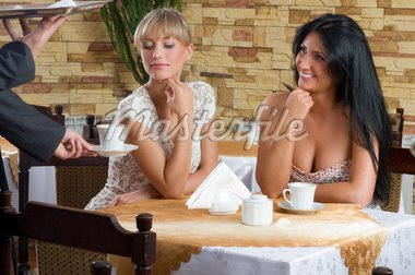 two friends waiting for the waiter taking cup of tea Stock Photo - Royalty-Free, Artist: carlodapino                   , Code: 400-04595285