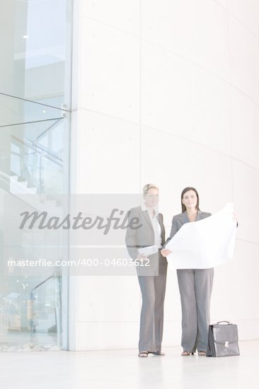 female architect holding blueprints Stock Photo - Royalty-Free, Artist: carlosseller                  , Code: 400-04603612