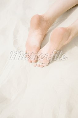 Close-up of two human soles lying on sandy beach Stock Photo - Royalty-Free, Artist: pressmaster                   , Code: 400-04623521