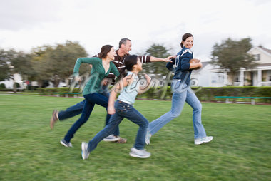 Family Playing Football Stock Photo - Premium Rights-Managed, Artist: Kevin Dodge, Code: 700-04625381