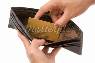 Hand taking gold credit card from wallet, the only concent in it. Stock Photo - Royalty-Free, Artist: OtnaYdur                      , Code: 400-04639312