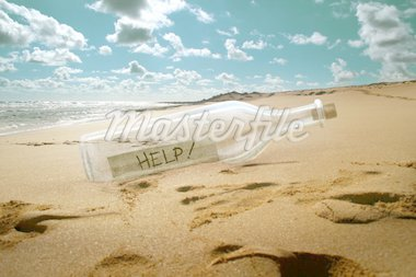 Help message in a bottle on beach Stock Photo - Royalty-Free, Artist: jordygraph                    , Code: 400-04699363