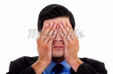Stock image of businessman covering his eyes with his hands, over white background Stock Photo - Royalty-Free, Artist: iodrakon                      , Code: 400-04707494