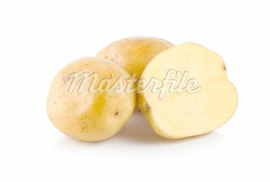 Three potatoes isolated on a white background Stock Photo - Royalty-Free, Artist: Givaga                        , Code: 400-04726135