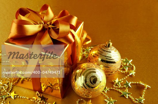 christmas gift in gold box with bow and silver balls Stock Photo - Royalty-Free, Artist: yasonya                       , Code: 400-04749473