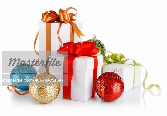 christmas gifts in with variegated bows and balls isolated on white background Stock Photo - Royalty-Free, Artist: yasonya                       , Code: 400-04751647
