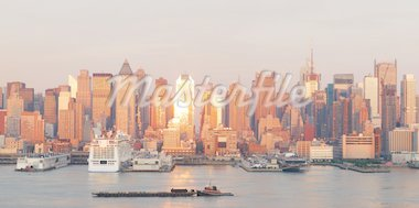 New York City Manhattan skyline panorama at sunset with skyscrapers and sunshine reflection over Hudson river. Stock Photo - Royalty-Free, Artist: rabbit75_cre                  , Code: 400-04758423