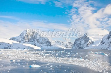 Beautiful snow-capped mountains against the blue sky in Antarctica Stock Photo - Royalty-Free, Artist: goinyk                        , Code: 400-04764550