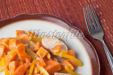 Chicken Sweet Potato and Pearl Onion Dinner with Sauce and Yellow Pepper Slivers. Stock Photo - Royalty-Free, Artist: brookebecker                  , Code: 400-04814108