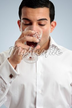 Closeup of a professional man drinking or tasting wine in a glass. Stock Photo - Royalty-Free, Artist: lovleah                       , Code: 400-04824608