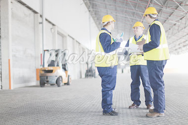 Workers talking in warehouse Stock Photo - Premium Royalty-Freenull, Code: 649-04827773