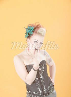 Beautiful retro woman with finger stuck in her mouth Stock Photo - Royalty-Free, Artist: creatista                     , Code: 400-04831298