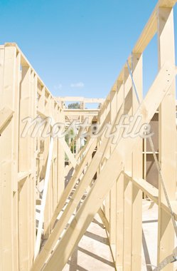 New residential construction home framing against a blue sky. Stock Photo - Royalty-Free, Artist: LevKr                         , Code: 400-04842335