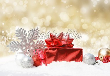 Glittery gold Christmas background with decorations in snow Stock Photo - Royalty-Free, Artist: kirstypargeter                , Code: 400-04902676