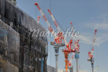Construction cranes working on a building Stock Photo - Royalty-Free, Artist: sepavo                        , Code: 400-04902928