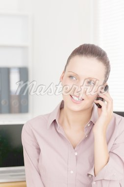 Businesswoman using a phone in an office Stock Photo - Royalty-Free, Artist: 4774344sean                   , Code: 400-04905296