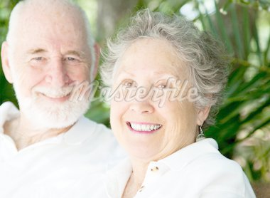 Portrait of a happy senior woman with her loving husband in background. Stock Photo - Royalty-Free, Artist: lisafx                        , Code: 400-04907423