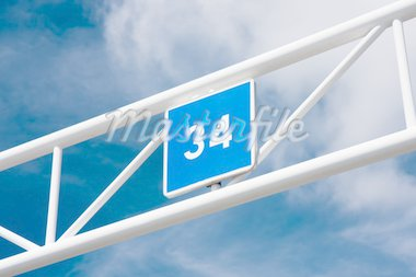 A blue sign showing the number 34 Stock Photo - Royalty-Free, Artist: DoctorJools                   , Code: 400-04909380