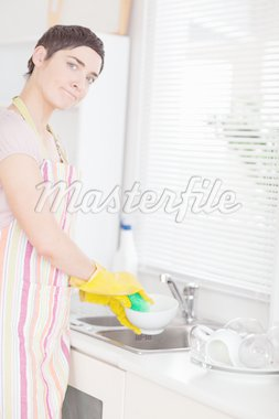 Woman washing the dishes looking into the camera in the kitchen Stock Photo - Royalty-Free, Artist: 4774344sean                   , Code: 400-04910785