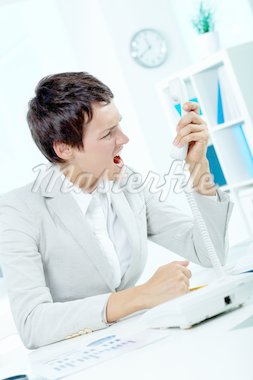 Image of annoyed boss losing her temper and screaming into phone receiver Stock Photo - Royalty-Free, Artist: pressmaster                   , Code: 400-04913415