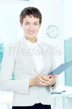 Photo of smart businesswoman with clipboard looking at camera Stock Photo - Royalty-Free, Artist: pressmaster                   , Code: 400-04913419