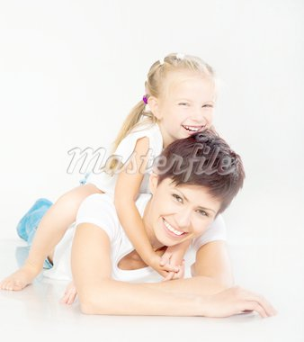 Mother and daughter laughing and looking at camera Stock Photo - Royalty-Free, Artist: GekaSkr                       , Code: 400-04913815