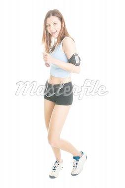 Running fitness women with mp3 player. Isolated on white Stock Photo - Royalty-Free, Artist: AndreyPopov                   , Code: 400-04915789