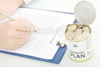 Businessman making financial plan - closeup on hands and an opened can with coins, top view Stock Photo - Royalty-Free, Artist: lightkeeper                   , Code: 400-04916159