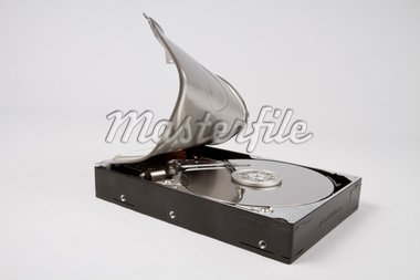 opened hard disk with bended cover in grey background Stock Photo - Royalty-Free, Artist: gewoldi                       , Code: 400-04916697