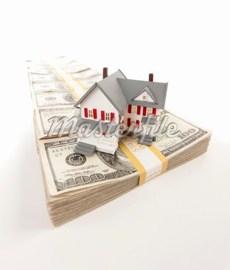 Small House on Row of Hundred Dollar Bill Stacks Isolated on a White Background. Stock Photo - Royalty-Free, Artist: Feverpitched                  , Code: 400-04916714