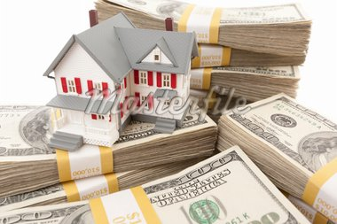 Small House with Stacks of Hundred Dollar Bills on White. Stock Photo - Royalty-Free, Artist: Feverpitched                  , Code: 400-04916725