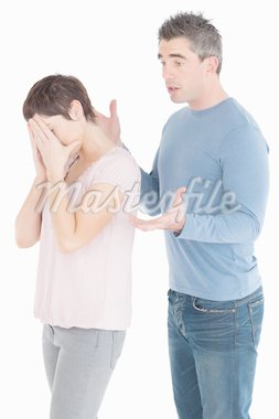 Wife crying while her husband is trying to explain himself against a white background Stock Photo - Royalty-Free, Artist: 4774344sean                   , Code: 400-04918335